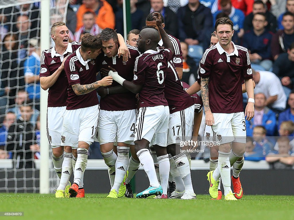 Danny Wilson (C) of Hearts is congratulated by team mates after he scoring the opening goal during the Scottish Championship Opening League Match between Rangers and Hearts, at Ibrox Stadium on August 10, 2014 Glasgow, Scotland.