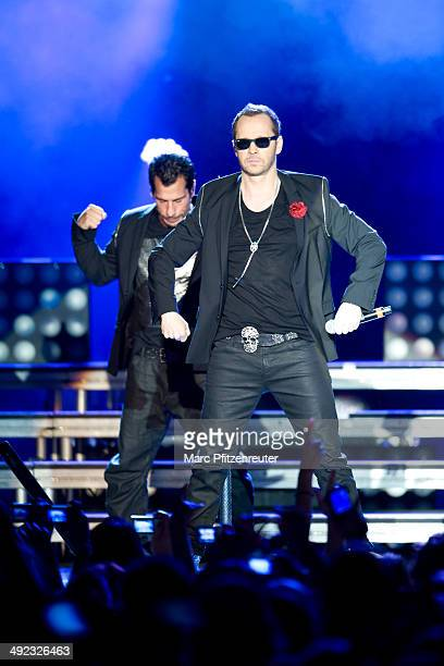 Danny Wood and Donnie Wahlberg of American Boygroup New Kids On The Block perform during their 'Let's get Intimate Tour 2014' at the Palladium on May...