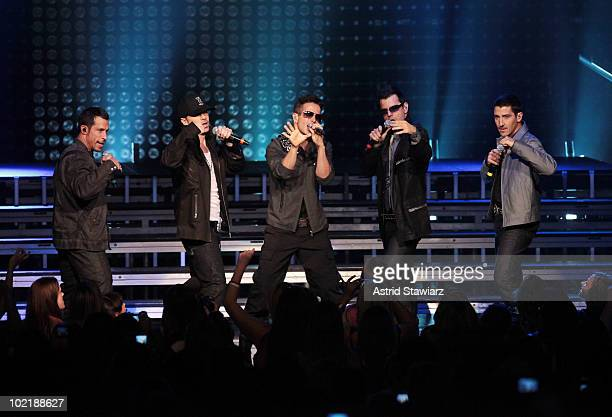 Danny Wood Donnie Wahlberg Joey McIntyre Jordan Knight and Jonathan Knight of the New Kids On The Block perform at Radio City Music Hall on June 17...