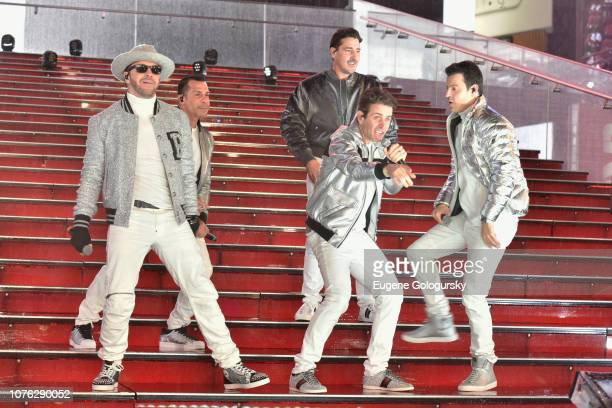 Danny Wood Donnie Wahlberg Jordan Knight Joey McIntyre and Jonathan Knight of New Kids on the Block perform on stage during Dick Clark's New Year's...