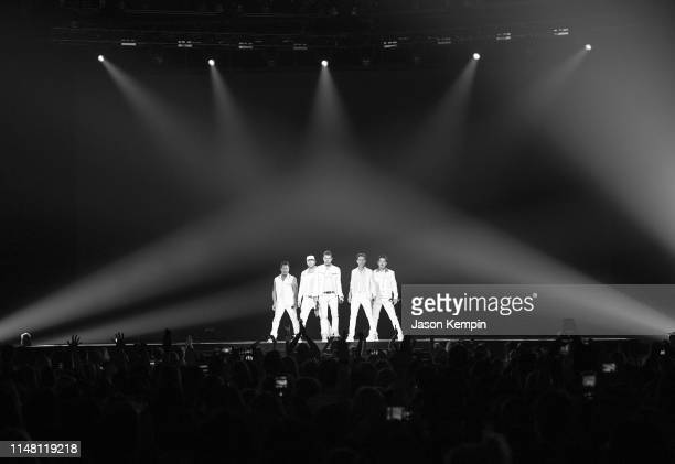 Danny Wood Donnie Wahlberg Jordan Knight Joey McIntyre and Jonathan Knight of the musical group New Kids On The Block perform at Bridgestone Arena on...