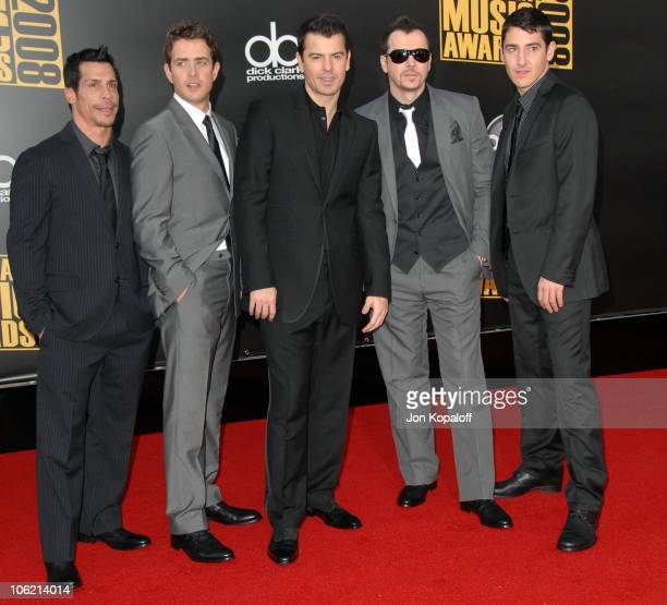 Danny Wood Joey McIntyre Jordan Knight Donnie Wahlberg and Jonathan Knight of New Kids on the Block arrive at the 2008 American Music Awards held at...