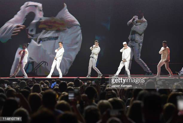 Danny Wood Joey McIntyre Jordan Knight Donnie Wahlberg and Jonathan Knight of the musical group New Kids On The Block perform at Bridgestone Arena on...