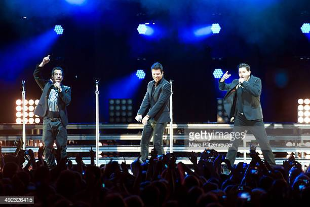Danny Wood Jordan Knight and Jonathan Knight of American Boygroup New Kids On The Block performs during their 'Let's get Intimate Tour 2014' at the...