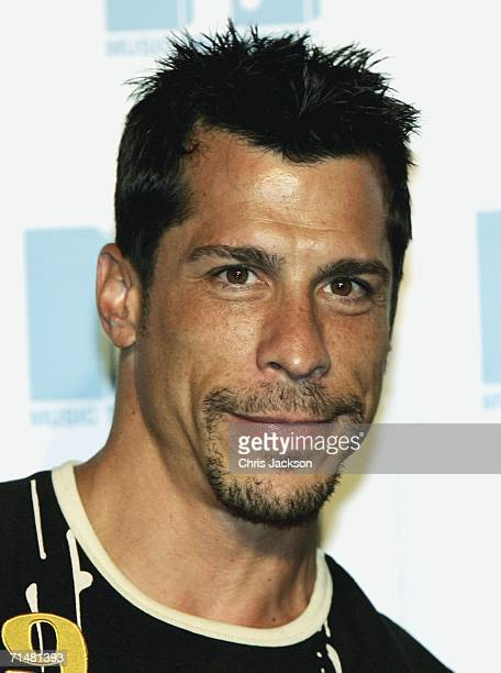 Danny Wood, member of the New MTV program 'Totally Boyband', poses for a photograph at an MTV press conference to introduce the new band, July 19,...