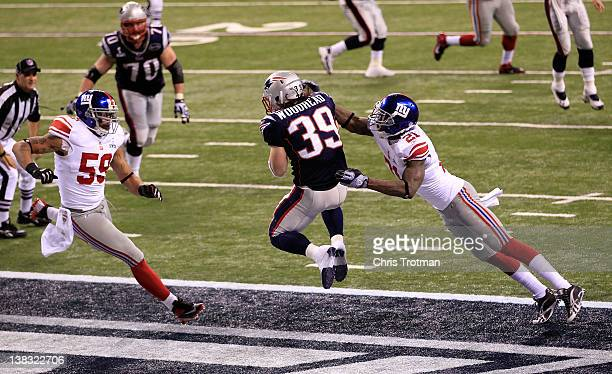 Danny Woodhead of the New England Patriots catches a three yard touchdown pass from Tom Brady in the second quarter against Kenny Phillips of the New...