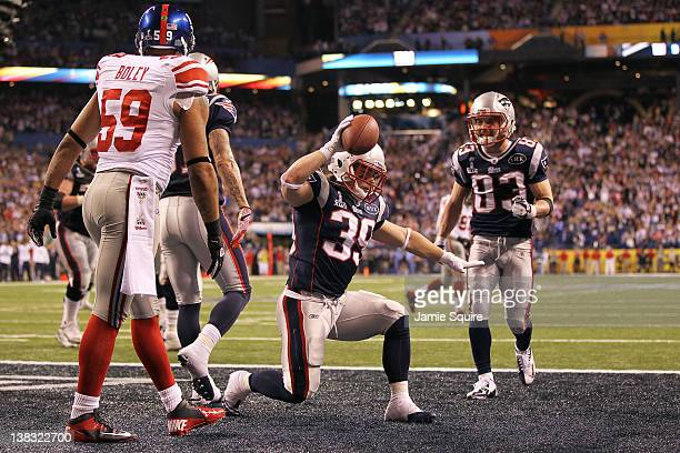 Danny Woodhead of the New England Patriots celebrates after catching a three yard touchdown pass from Tom Brady in the second quarter against the New...