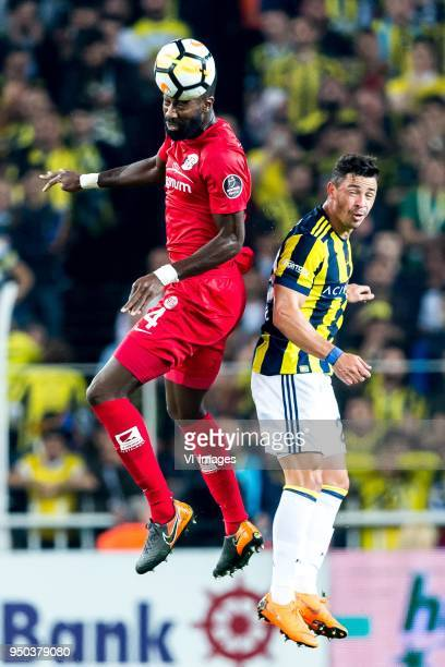 Danon Issouf Johannes Djourou Gbadjere of Antalyaspor AS Giuliano Victor de Paula of Fenerbahce SK during the Turkish Spor Toto Super Lig match...