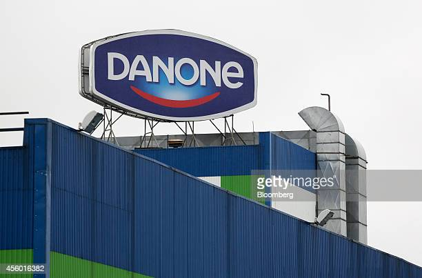 A Danone logo sits on display above the Group Danone in Russia dairy production plant operated by Danone SA in Saint Petersburg Russia on Tuesday...