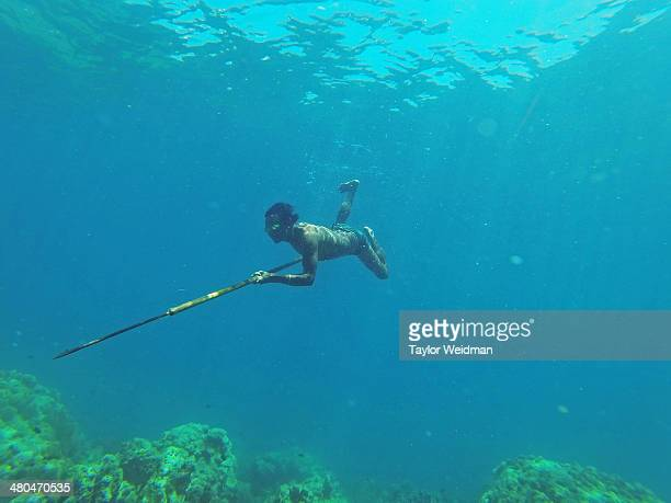 Danong an indigenous Moken man hunts for fish using a traditional bamboo spear near his village in Ko Surin National Park Thailand Often called sea...