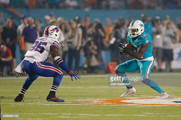 Da'Norris Searcy of the Buffalo Bills defends against Jarvis Landry of the Miami Dolphins as he runs with the ball on November 13 2014 at Sun Life...