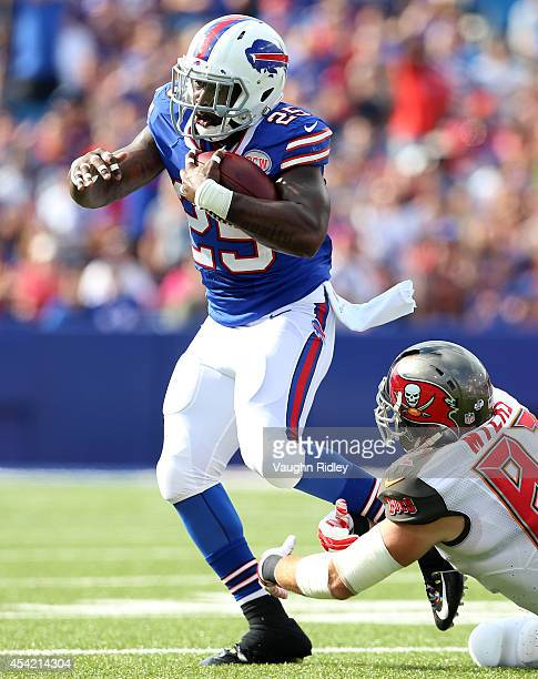Da'Norris Searcy of the Buffalo Bills is tackled by Brandon Myers of the Tampa Bay Buccaneers at Ralph Wilson Stadium on August 23 2014 in Orchard...