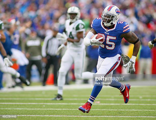 Da'Norris Searcy of the Buffalo Bills returns against the New York Jets interception for a 32 yard touchdown against the New York Jets at Ralph...