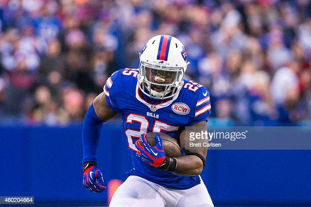 Da'Norris Searcy of the Buffalo Bills runs the ball after an interception against the Cleveland Browns on November 30 2014 at Ralph Wilson Stadium in...