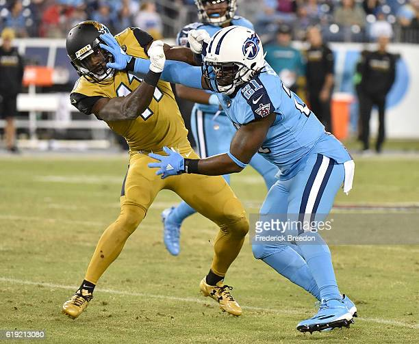 Da'Norris Searcy of the Tennessee Titans plays against Marqise Lee of the Jacksonville Jaguars at Nissan Stadium on October 27 2016 in Nashville...