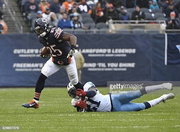 Da'Norris Searcy of the Tennessee Titans tackles Brandon Boykin of the Chicago Bears during the third quarter on November 27 2016 at Soldier Field in...