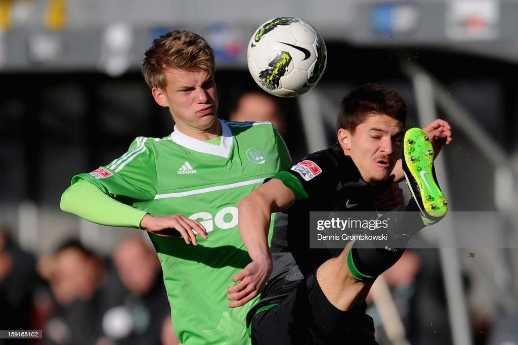 Dan-Patrick Poggenberg of Wolfsburg challenges Aleksandar Ignjovski of Bremen during the friendly match between Werder Bremen and VfL Wolfsburg at Mardan Palace Stadium on January 9, 2013 in Kundu, Turkey.