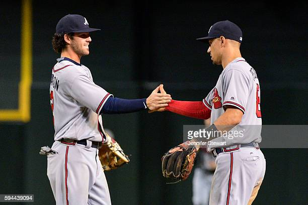Dansby Swanson and Jace Peterson of the Atlanta Braves celebrate after closing out the game against the Arizona Diamondbacks at Chase Field on August...