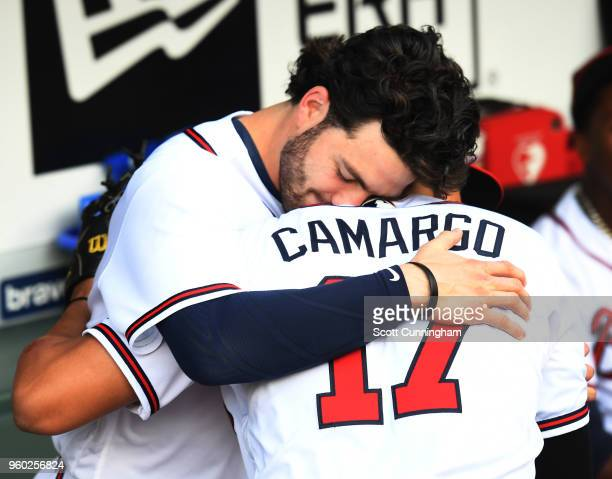 Dansby Swanson and Johan Camargo of the Atlanta Braves embrace before the game against the Miami Marlins at SunTrust Field on May 19, 2018 in...