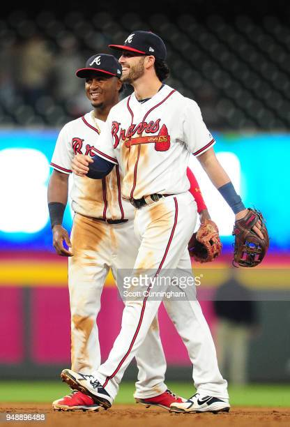 Dansby Swanson and Ozzie Albies of the Atlanta Braves celebrate after the game against the New York Mets at SunTrust Park on April 19 2018 in Atlanta...