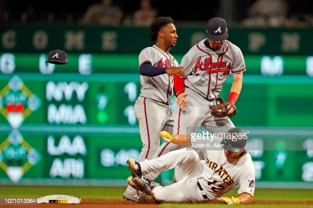 Dansby Swanson and Ozzie Albies of the Atlanta Braves collide while attempting to field a double play ball in the sixth inning against Corey...