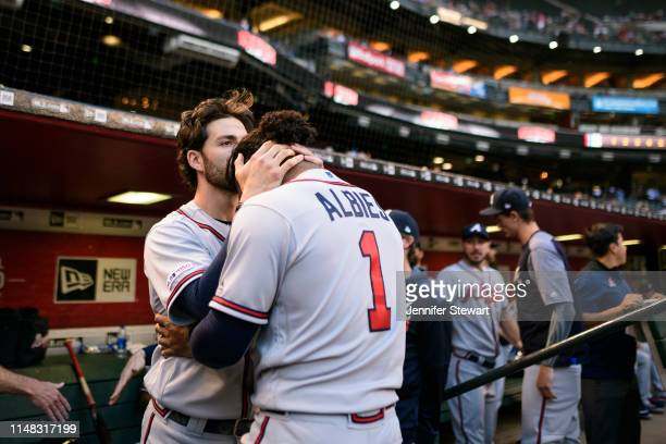 Dansby Swanson and Ozzie Albies of the Atlanta Braves prepare for the game against the Arizona Diamondbacks at Chase Field on May 10 2019 in Phoenix...