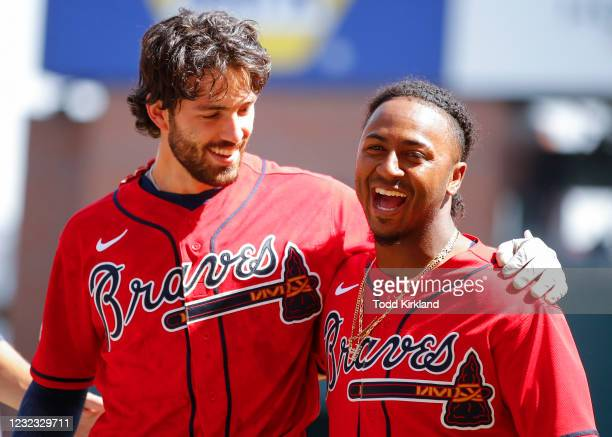 Dansby Swanson celebrates the victory with Ozzie Albies of the Atlanta Braves at the conclusion of an MLB game against the Miami Marlins at Truist...