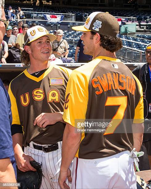 Dansby Swanson of the Atlanta Braves and Team USA talks with Carson Fulmer of the Chicago White Sox and Team USA prior to the SiriusXM AllStar...