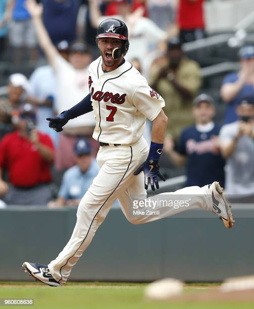 Dansby Swanson of the Atlanta Braves celebrates after hitting a tworun gamewinning walkoff single in the ninth inning during the game against the...