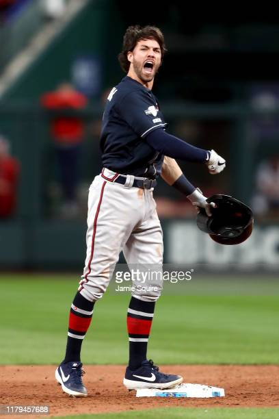 Dansby Swanson of the Atlanta Braves celebrates after hitting an RBI double to tie the game against the St Louis Cardinals during the ninth inning in...
