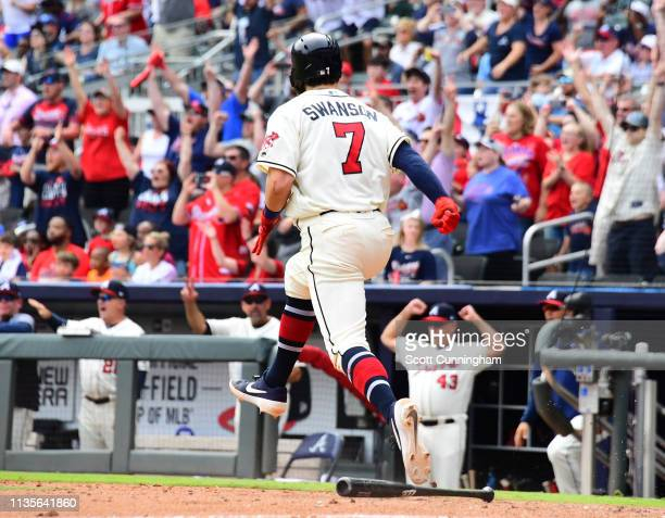 Dansby Swanson of the Atlanta Braves celebrates after knocking in the gamewinning run in the ninth inning against the Miami Marlins at SunTrust Park...
