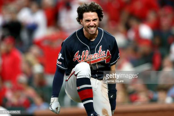 Dansby Swanson of the Atlanta Braves celebrates after scoring a run against the St Louis Cardinals during the ninth inning in game three of the...
