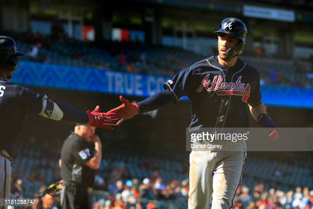Dansby Swanson of the Atlanta Braves celebrates scoring on an RBI single off the bat of Austin Riley in the 13th inning against the San Francisco...