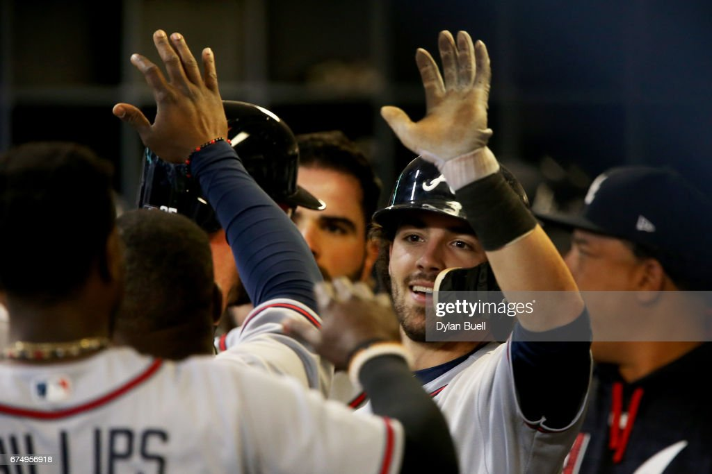 Dansby Swanson #7 of the Atlanta Braves celebrates with teammates after hitting a home run in the seventh inning against the Milwaukee Brewers at Miller Park on April 29, 2017 in Milwaukee, Wisconsin.