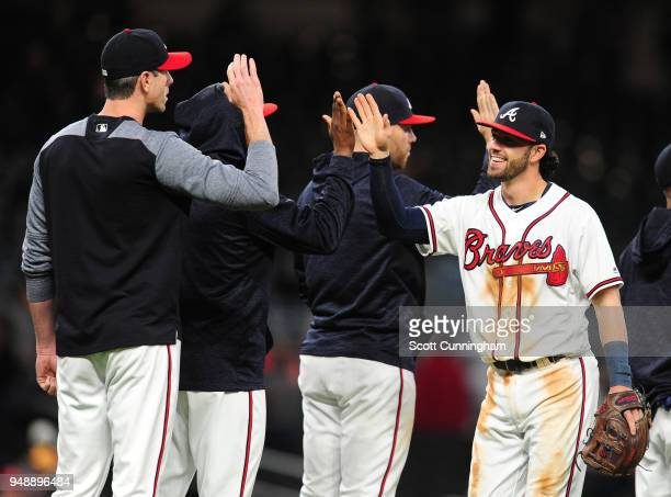 Dansby Swanson of the Atlanta Braves celebrates with teammates after the game against the New York Mets at SunTrust Park on April 19 2018 in Atlanta...