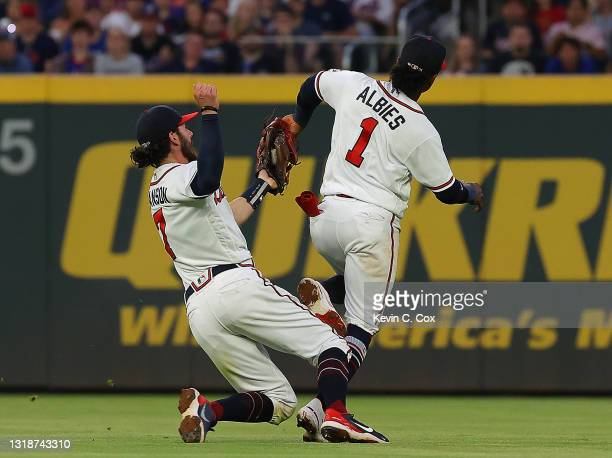 Dansby Swanson of the Atlanta Braves chases down and catches a pop out by Jonathan Villar of the New York Mets to end the fifth inning at Truist Park...