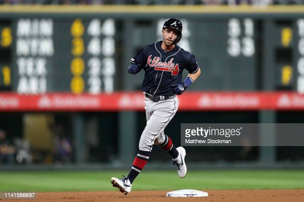Dansby Swanson of the Atlanta Braves circles the bases after hitting a 3 RBI home run in the fourth inning against the Colorado Rockies at Coors...