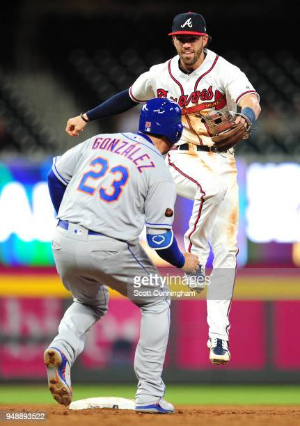 Dansby Swanson of the Atlanta Braves completes a ninthinning gameending double play against Adrian Gonzalez of the New York Mets at SunTrust Park on...