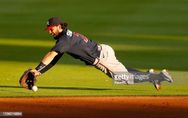 Dansby Swanson of the Atlanta Braves dives but fails to scoop up this ground ball hit by Charlie Culberson during the first intrasquad game of summer...
