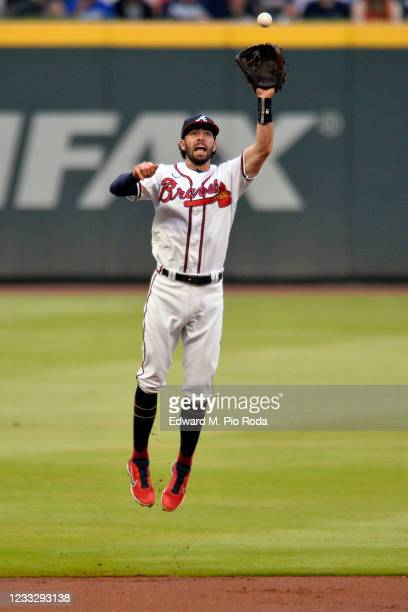 Dansby Swanson of the Atlanta Braves fields a line drive hit by Chris Taylor of the Los Angeles Dodgers in the first inning at Truist Park on June 5,...