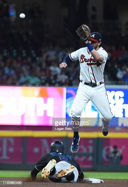 Dansby Swanson of the Atlanta Braves fields the ball against the Miami Marlins at SunTrust on April 06 2019 in Atlanta Georgia