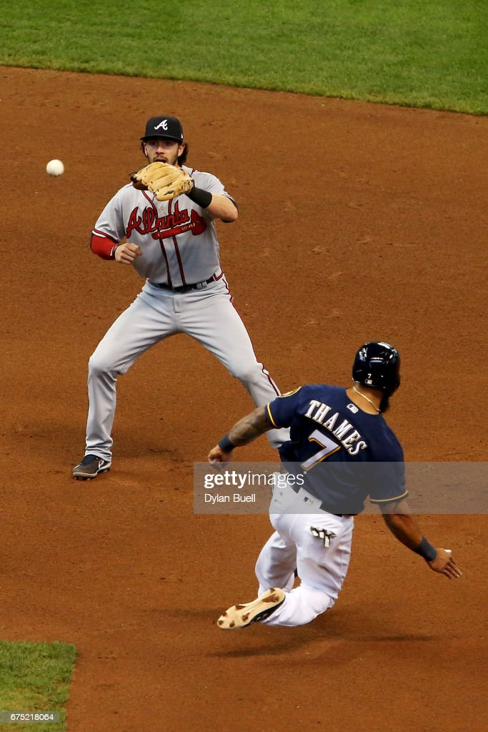 Dansby Swanson #7 of the Atlanta Braves forces out Eric Thames #7 of the Milwaukee Brewers at second base in the sixth inning at Miller Park on April 30, 2017 in Milwaukee, Wisconsin.