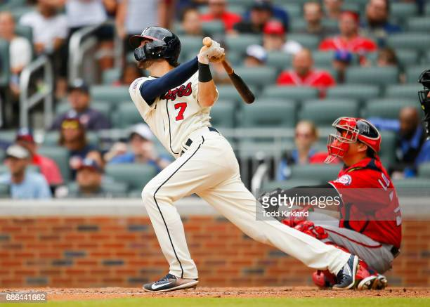 Dansby Swanson of the Atlanta Braves hits a double scoring two runs in the eight inning of an MLB game against the Washington Nationals at SunTrust...