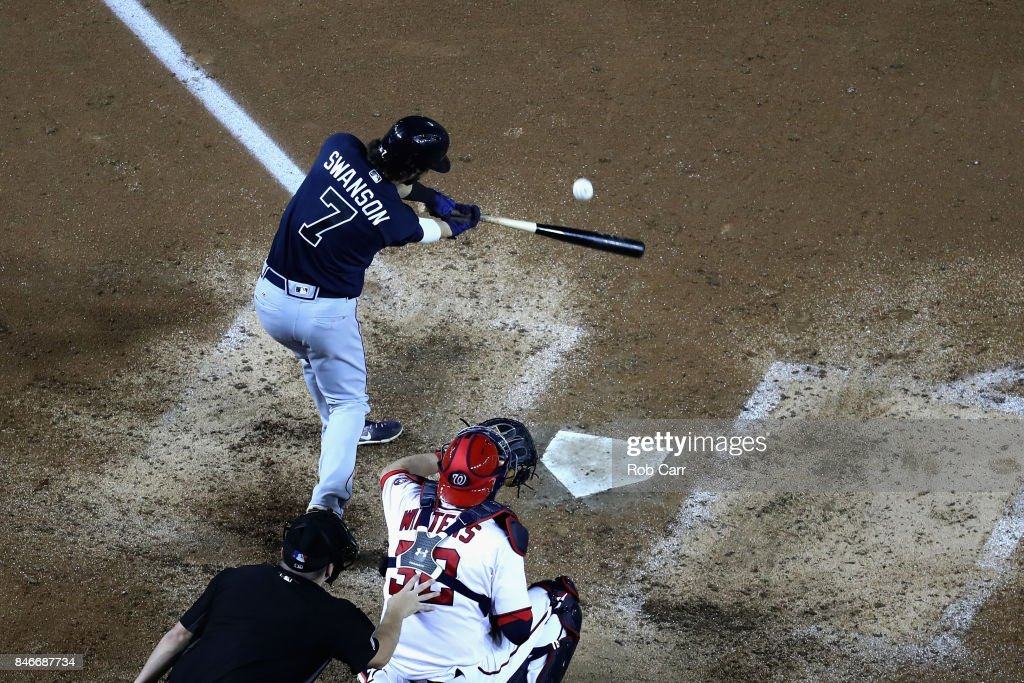 Dansby Swanson #7 of the Atlanta Braves hits a two RBI single against the Washington Nationals in the seventh inning at Nationals Park on September 13, 2017 in Washington, DC.