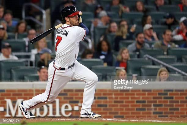 Dansby Swanson of the Atlanta Braves hits an RBI single during the fourth inning against the Philadelphia Phillies at SunTrust Park on March 30 2018...