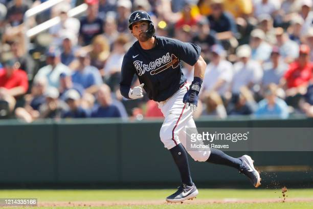 Dansby Swanson of the Atlanta Braves in action against the Houston Astros during a Grapefruit League spring training game at CoolToday Park on March...