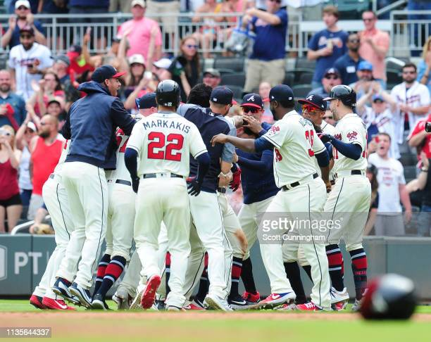 Dansby Swanson of the Atlanta Braves is congratulated by teammates after knocking in the gamewinning run in the ninth inning against the Miami...