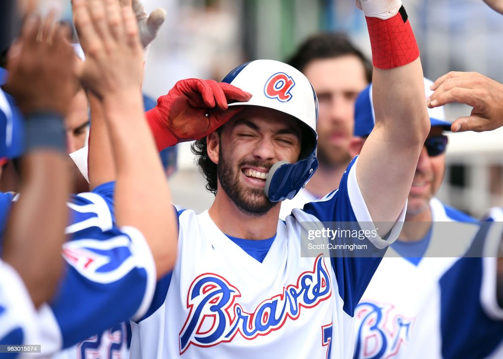 Dansby Swanson #7 of the Atlanta Braves is congratulated by teammates after hitting an eighth inning pinch-hit two run home run against the Baltimore Orioles at SunTrust Park on June 24, 2018 in Atlanta, Georgia.