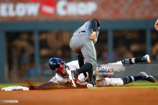 Dansby Swanson of the Atlanta Braves is picked off trying to steal second base by Wilmer Flores of the Arizona Diamondbacks in the second inning of...