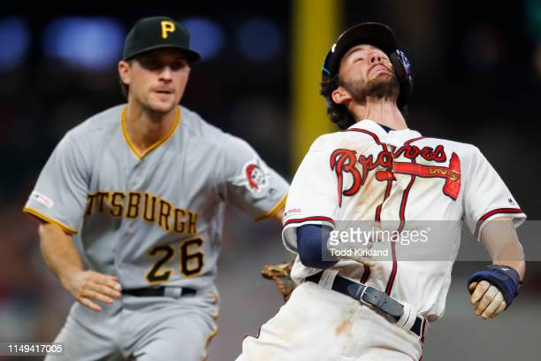 Dansby Swanson of the Atlanta Braves is run down and tagged out by Adam Frazier of the Pittsburgh Pirates in the fifth inning of an MLB game at...